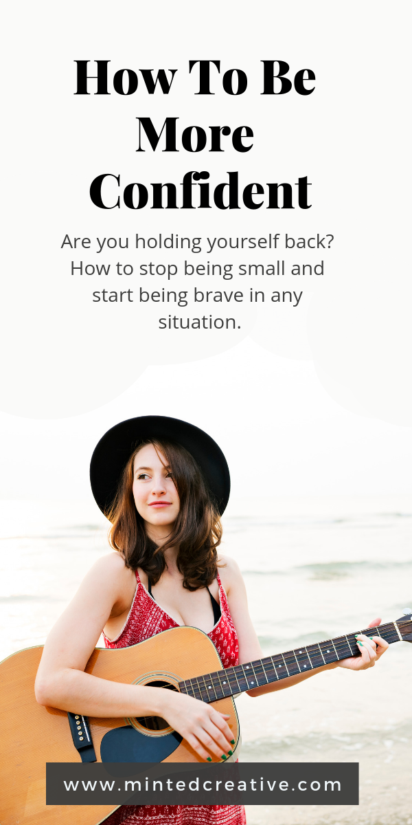 brunette with a guitar and text overlay - how to be more confident. are you holding yourself back? how to stop being small and start being brace in any situation