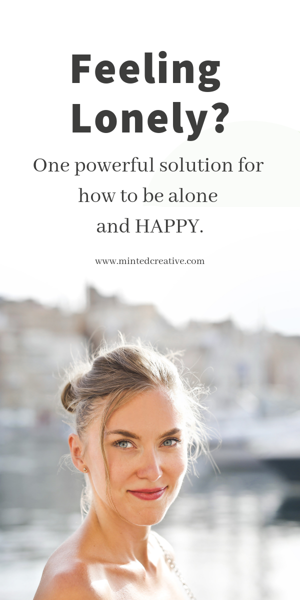 portrait of brunette woman with text overlay - feeling lonely? one powerful solution for how to be alone and happy